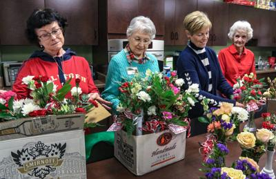 Hospice volunteers prepare Valentine flowers