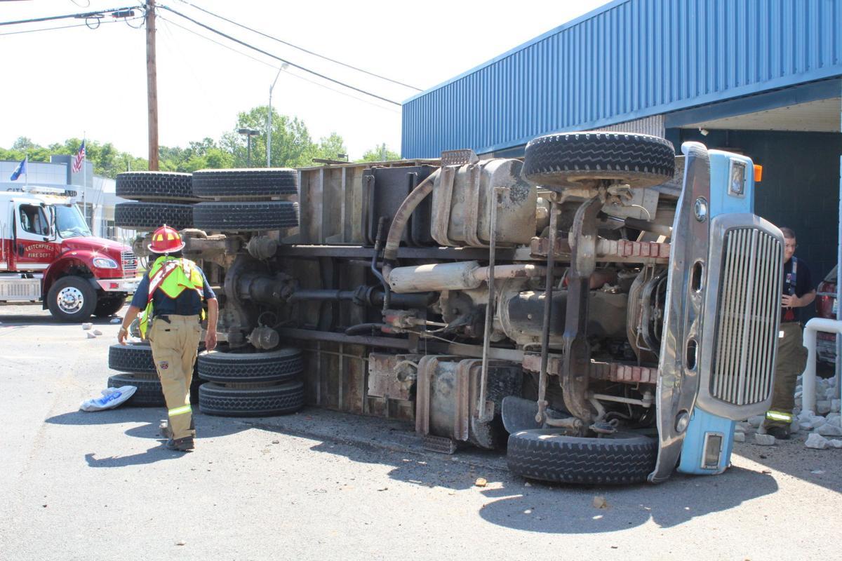Dump truck crashes at car wash, driver injured 2