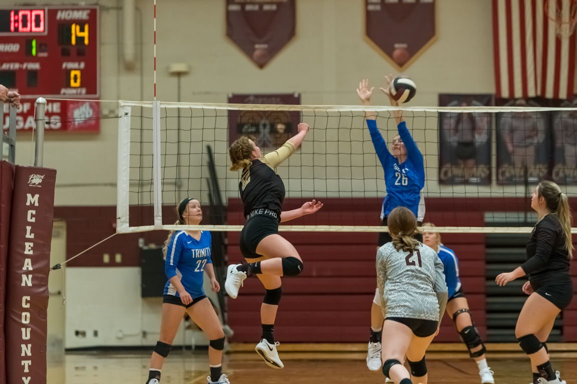Lady Cougar netters drop two matches
