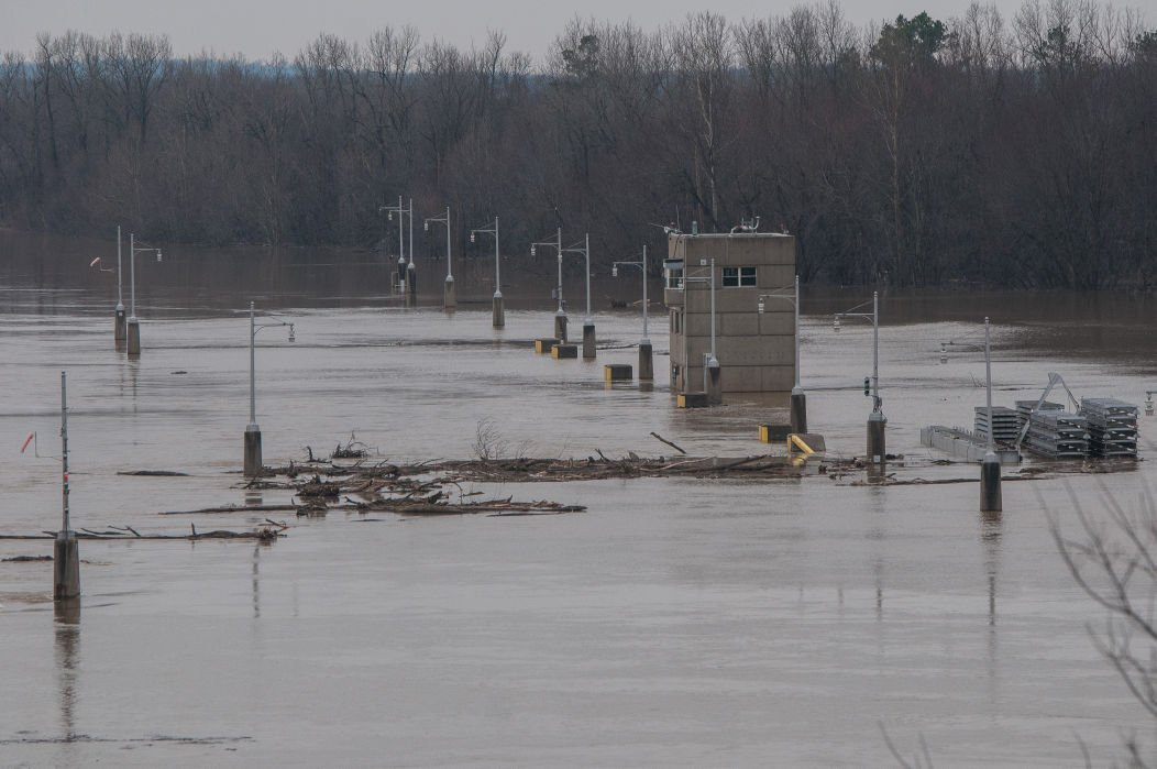 Flood waters close county streets, submerge river banks