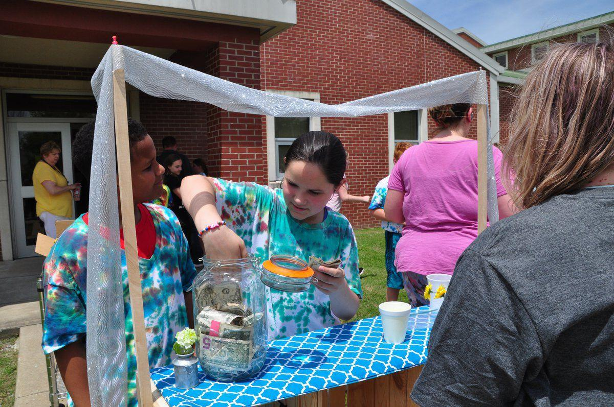 Lemonade stand raises funds for bike giveaway