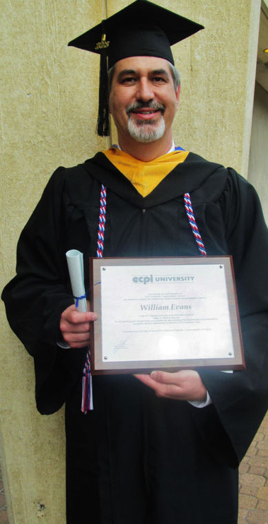 william burt evans jr 51 holds his diploma after graduating from ecpi university with a bachelors degree in computer information science june 22