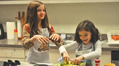 two-girls-cooking-df2000893480.jpg