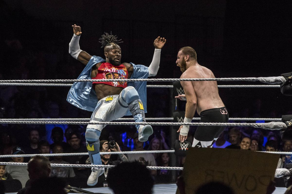 WWE Champion Kofi Kingston (L) hitting the Trouble in Paradise maneuver on Sami Zayn (R) at a recent WWE Live event in Petersburg.