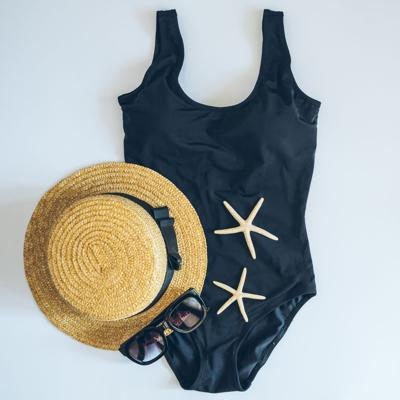 flat lay with swimming clothes. fashion. summer concept