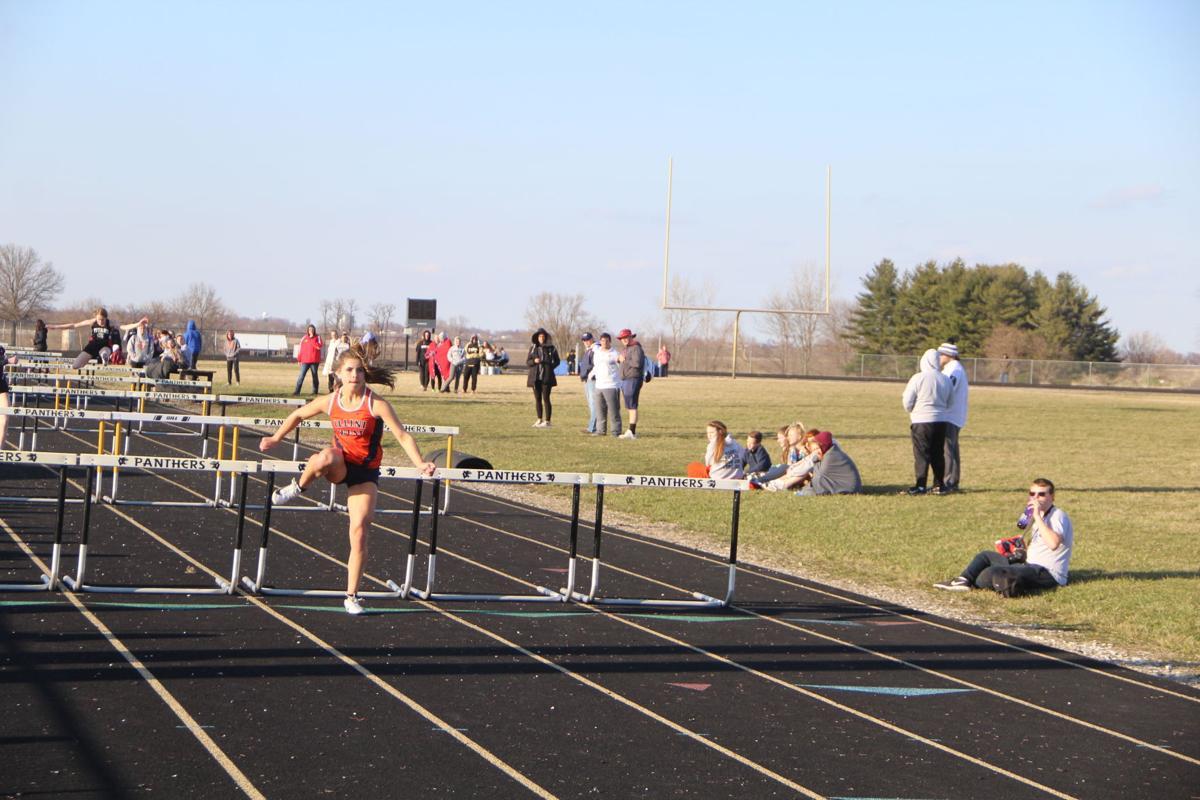 Karilee Artman  Win the 100 meter hurdles