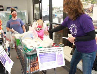 Collecting items for battered women's shelter