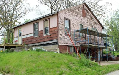 NEWS Pink house to be sided.JPG