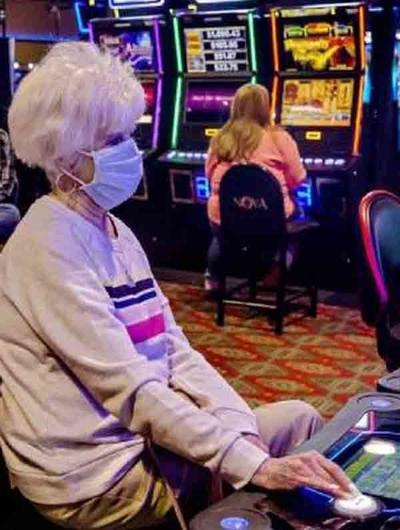 Casino patron wearing mask