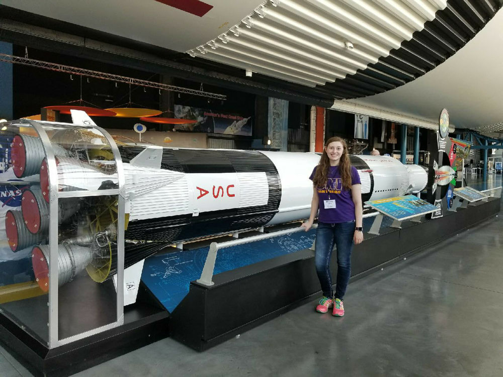 Central lee grad mallory wills tours space flight center daily wills next to rocket solutioingenieria Images