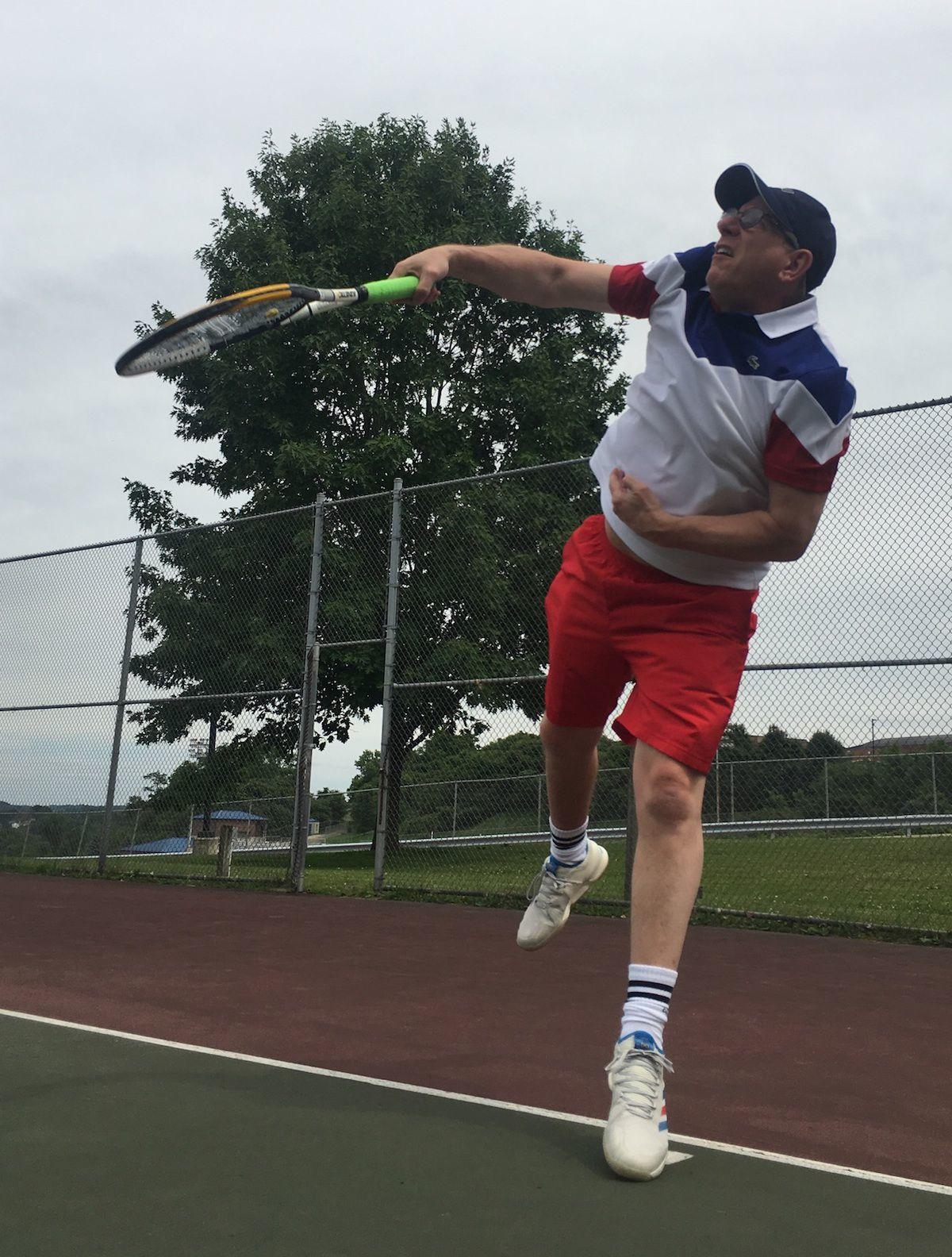 Toops practices a serve