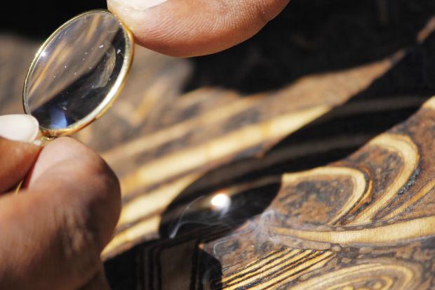Missoula Woodburning Artist Finds Place Under Sun Territory - Artist creates art power sunlight magnifying glass