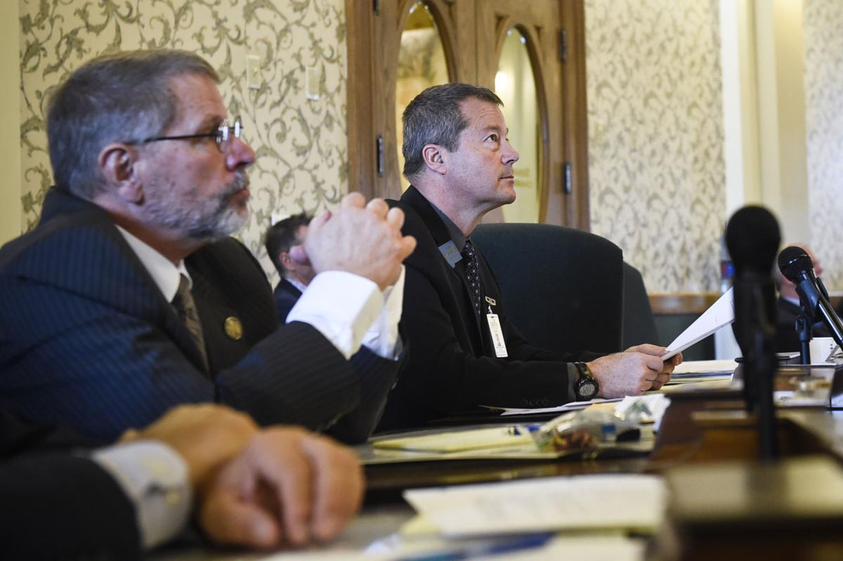 """Sen. Albert Olszewski (R- Kalispell), center, proposed Tuesday to halt a change made by the Department of Public Health and Human Services to use the word """"gender"""" instead of """"sex"""" on birth certificates, saying it would cost extra money."""