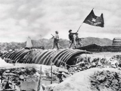 Viet Minh troops plant their flag over a captured French position.