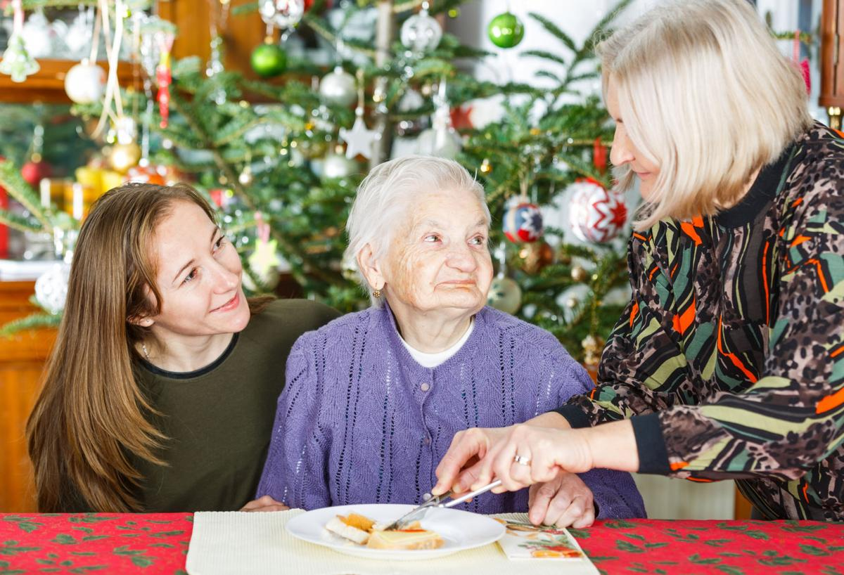 Elderly woman dining with family during holidays