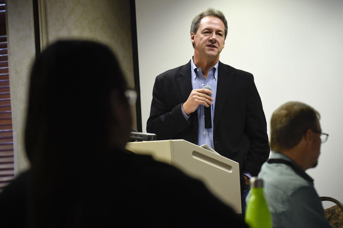 Gov. Steve Bullock speaks to representatives from Montana's Native American communities Wednesday morning during the first day of the two-day Zero Suicide Academy in Helena.