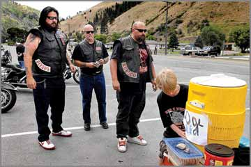 Hells Angels arrive: Members of motorcycle club roar into town and
