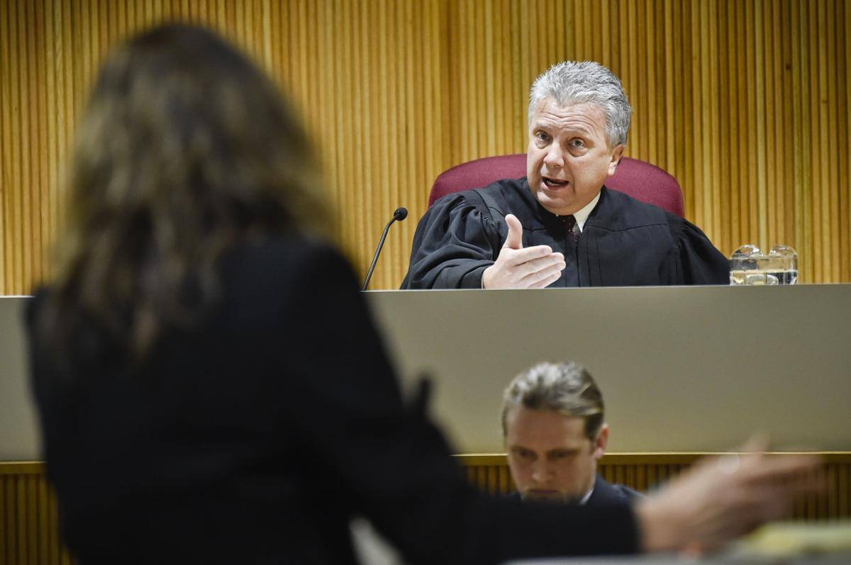 Montana Supreme Court Justice Dirk Sandefur, right, questions Maureen Lennon,
