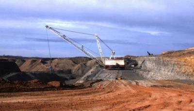 A dragline moves overburden covering a coal seam