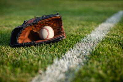 Baseball mitt and ball in grass stockimage