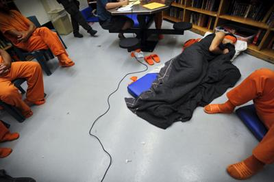 An inmate sleeps on the floor of the Lewis and Clark County Detention Center