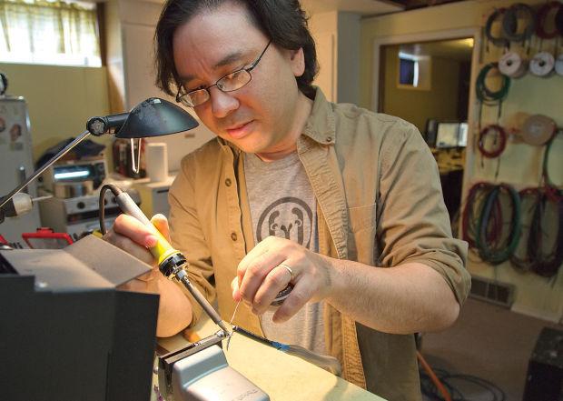 Donovan solders a guitar plug