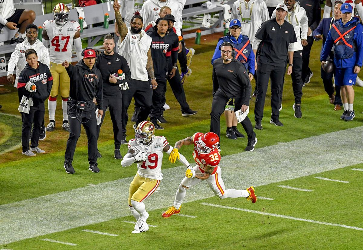 San Francisco 49ers wide receiver Deebo Samuels (19) runs down field towards the endzone as Kansas City Chiefs safety Tyrann Mathieu (32) chases him down during the first quarter of Super Bowl 54 at Hard Rock Stadium in Miami Gardens, FL on Sunday, February 2, 2020.