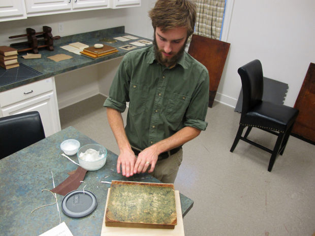 Brien Beidler, the bookbinder at the Charleston Library Society