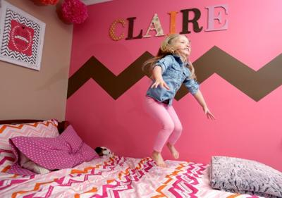 Claire Lee jumps on her bed
