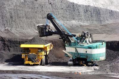 A mechanized shovel loads coal