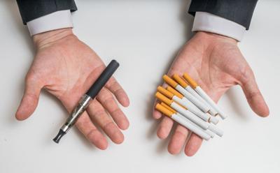 Vaping vs cigarettes stockimage