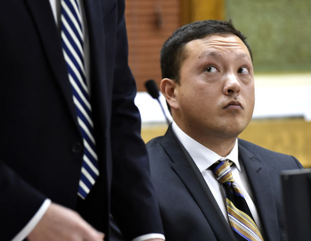 Markus Kaarma listens to his defense attorneys