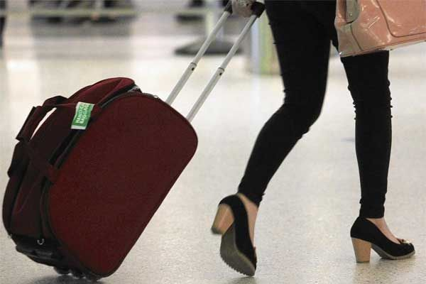 Woman with carry-on bag