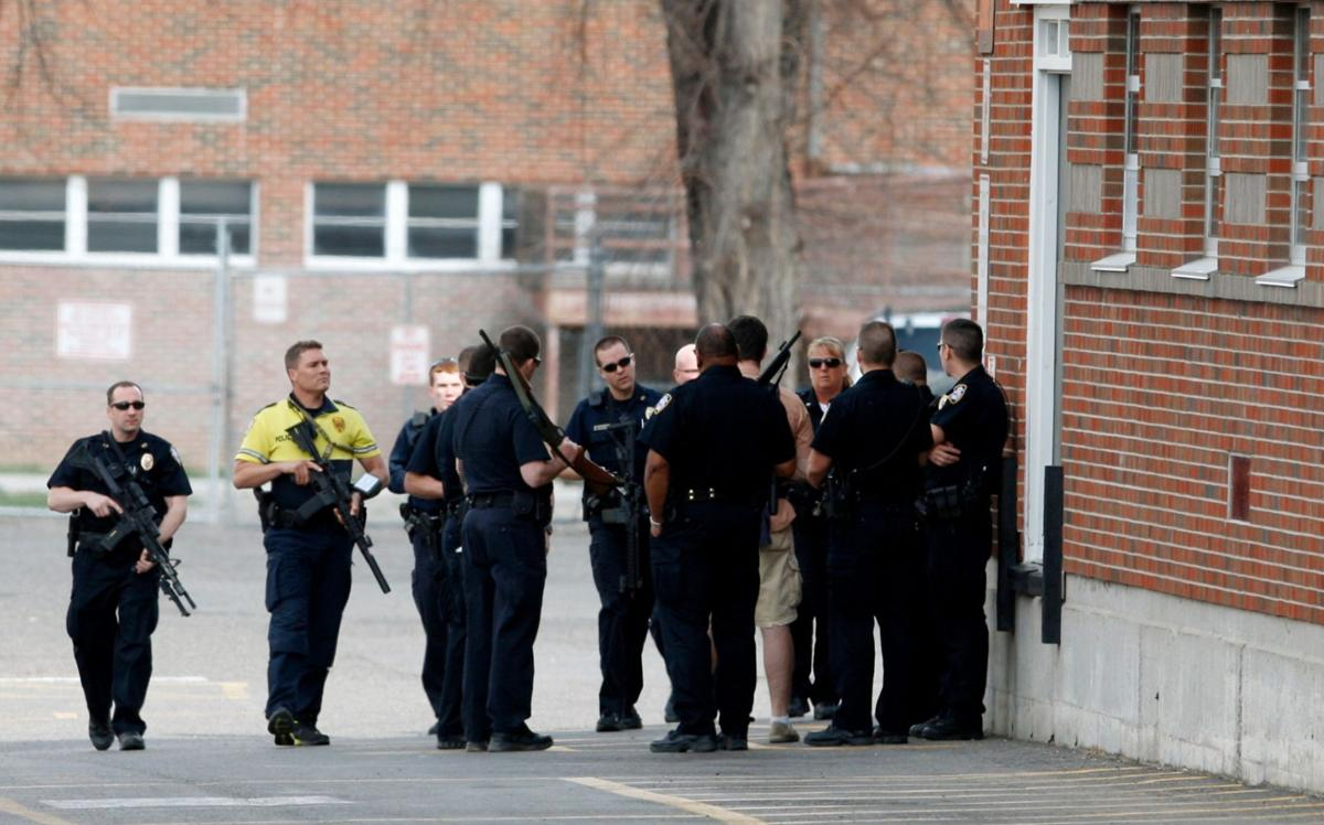 Billings police officers gather at the northeast corner
