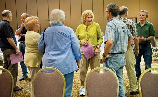 Tricia Brown, center, chats with her 1962 classmates