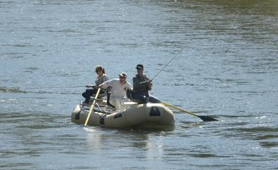 Anglers in a raft float the lower Blackfoot River