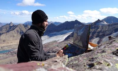Nic Fischer paints on the summit