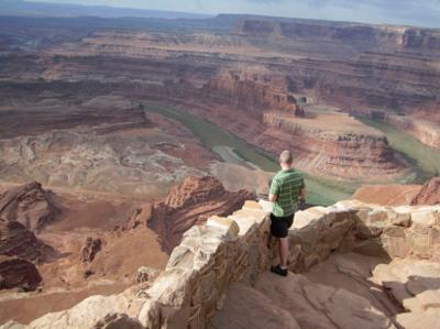 A tourist enjoys the view from Dead Horse Point State Park