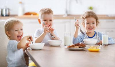 Happy children eating at a table