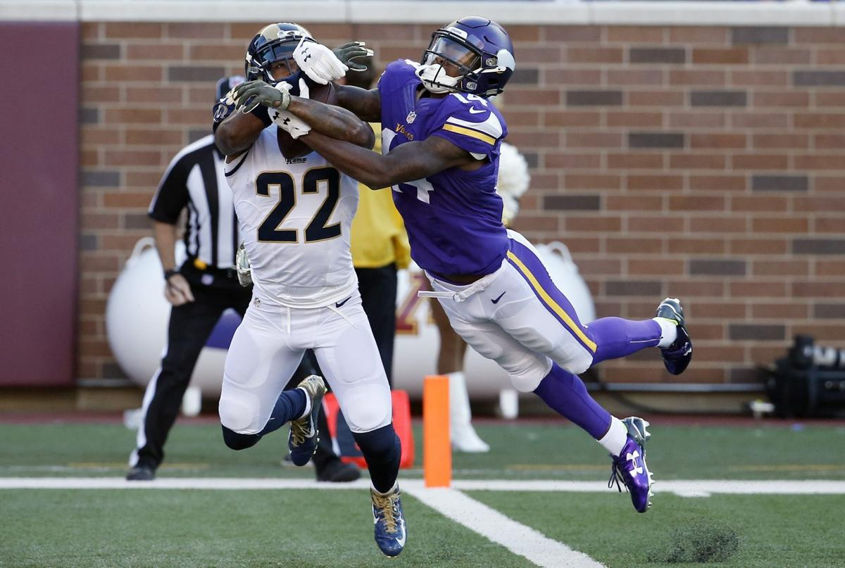 Griz in the NFL Johnson picks off a pass in Rams loss to Vikings