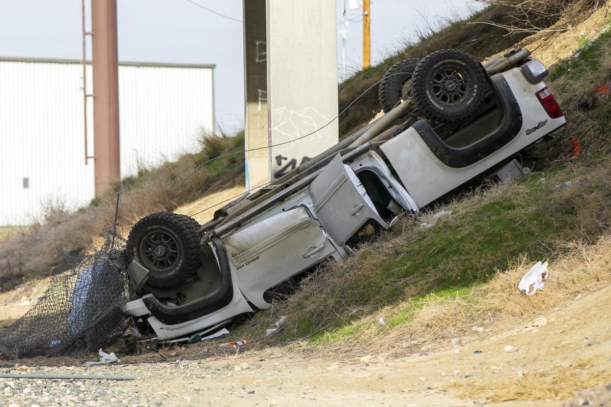 Truck rolls off I-90