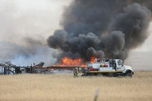 Fire burns cars, 3 structures east of Huntley, sends 1 to hospital
