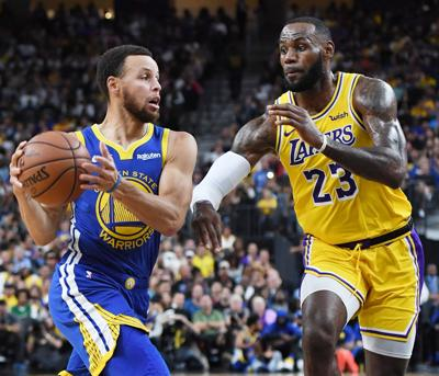 Stephen Curry #30 of the Golden State Warriors drives against LeBron James #23 of the Los Angeles Lakers during their preseason game at T-Mobile Arena on October 10, 2018 in Las Vegas, Nev.