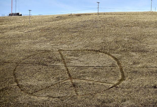 030915-mis-nws-peace-vandals