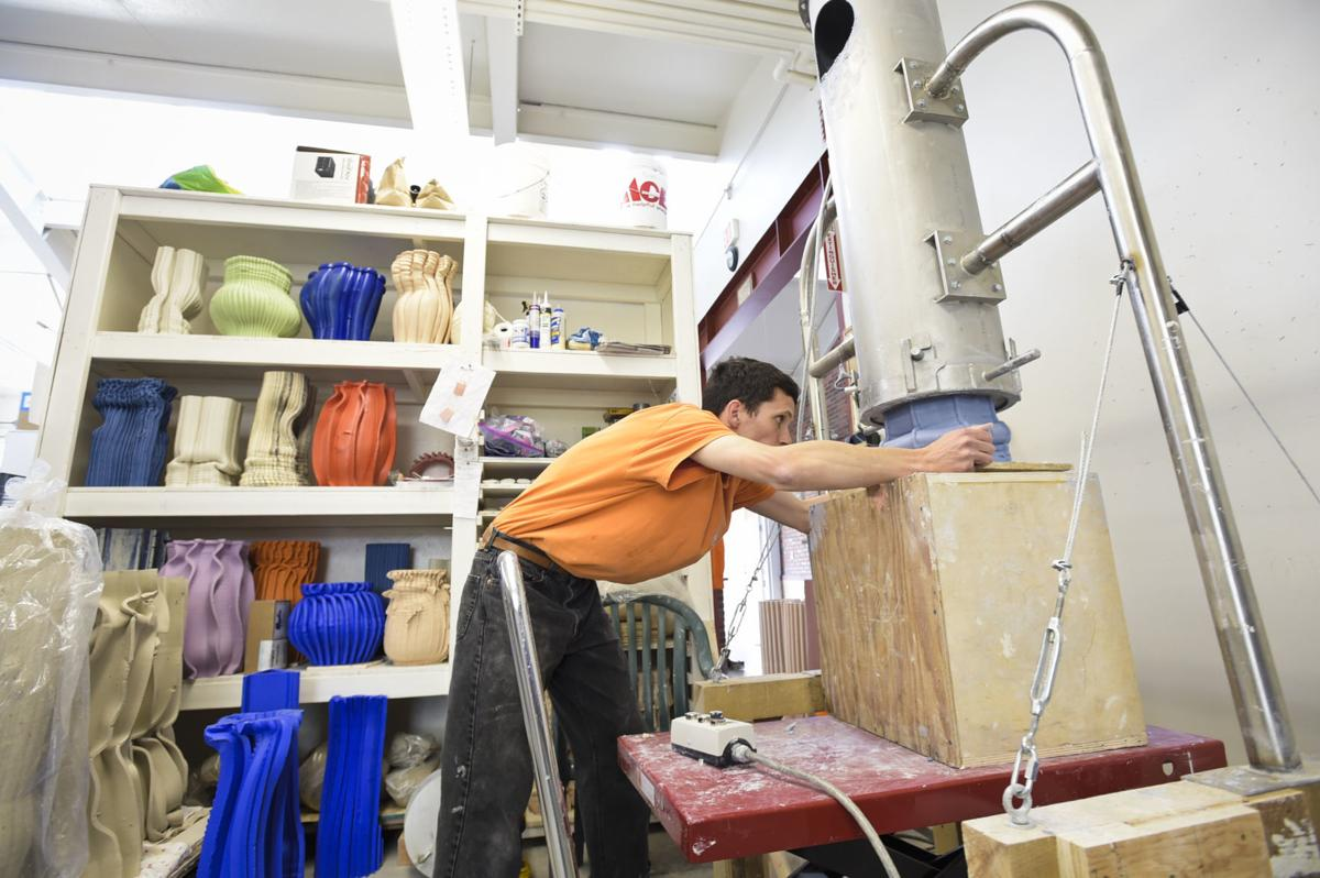 Anton Alvarez works on a piece of art recently in his Archie Bray studio using a clay extruding machine