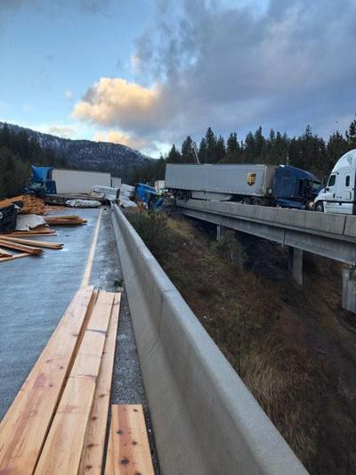 Two dead in early morning tractor-trailer pileup on icy I-90 west of