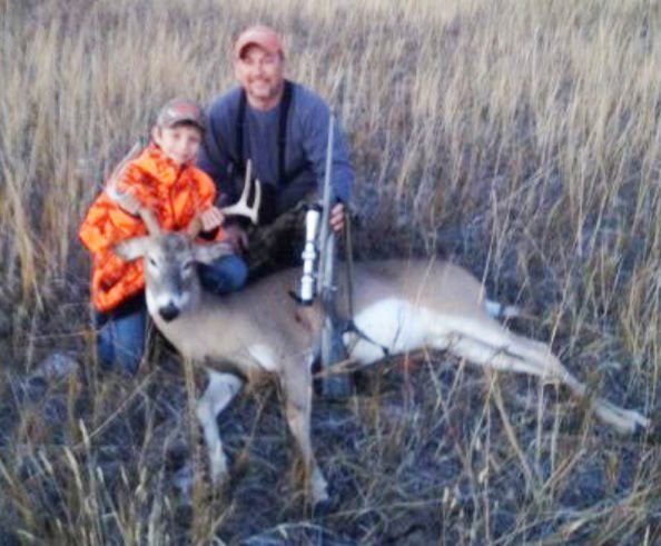 Hunter and Dan Edens with deer