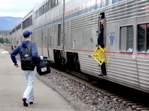 A passenger boards the Amtrak