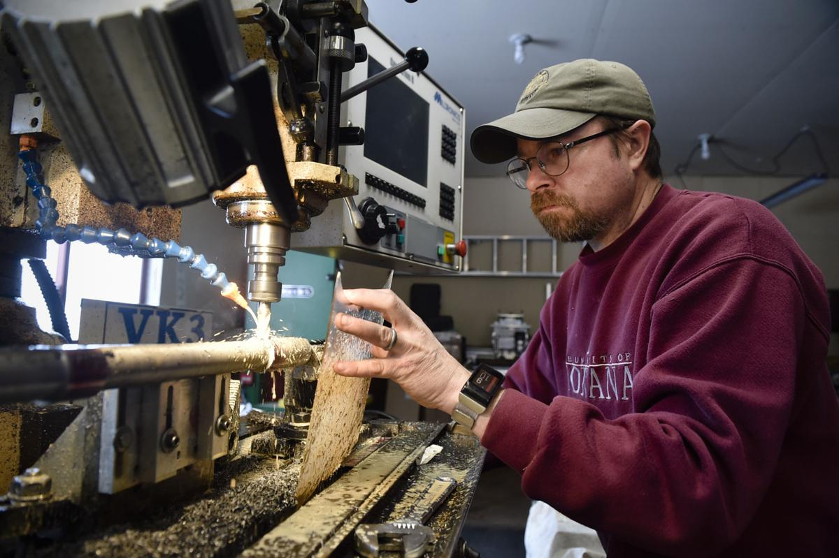 John McLaughlin machines a sight rail into the barrel