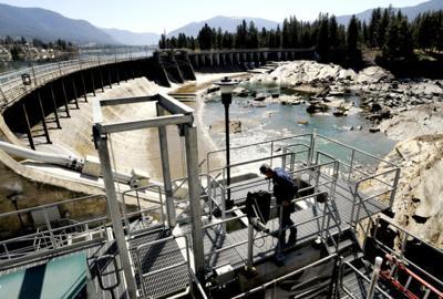 Brent Mabbott, senior fisheries biologist for PPL Montana, checks the water level